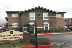 Exterior of Geneva Pointe with sign