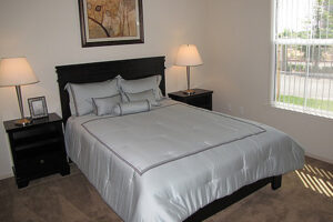 Elk Grove, CA Affordable Apartments - Geneva Pointe Bedroom with Plush Carpet and Large Closet